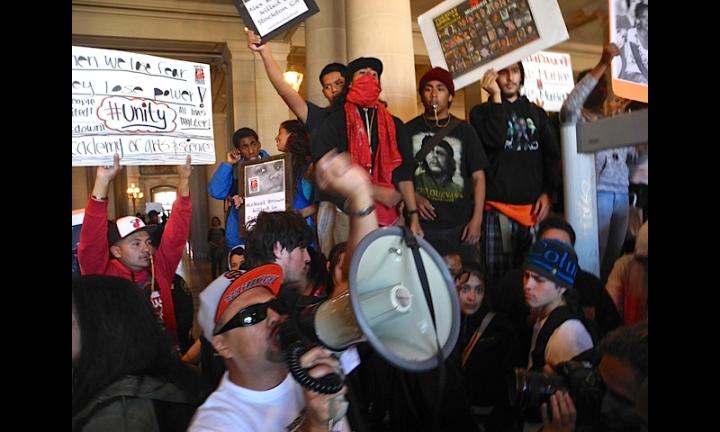 35-SF_Professor Ben Bac Sierra- SF City College leads chant inside SF City Hall