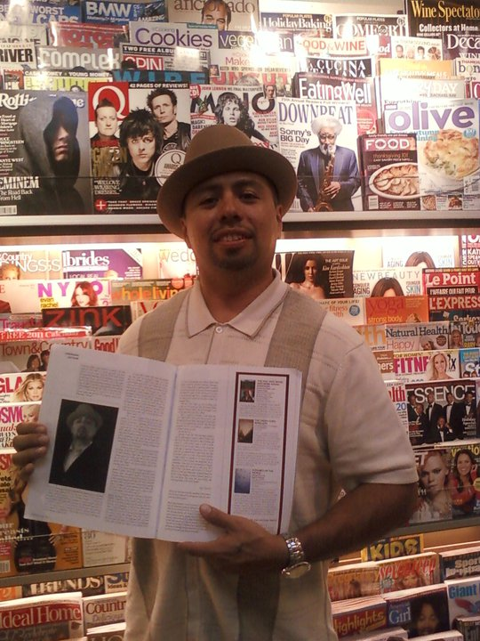 Posing with World Literature Today Magazine Article about Barrio Bushido